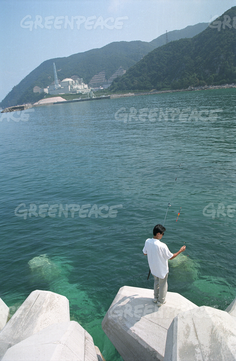 People fishing close to Monju nuclear plant. Tsuruga, Japan.