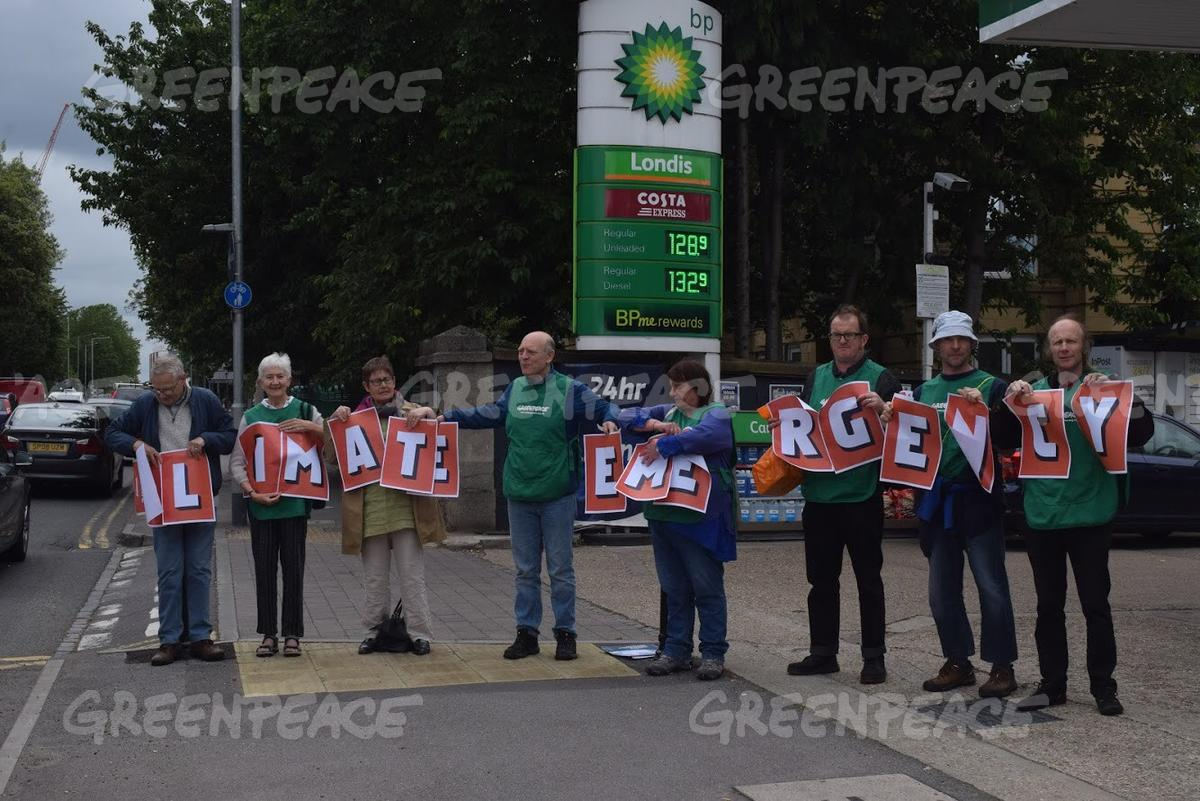 Volunteers in Reading Protest outside a BP Petrol Station
