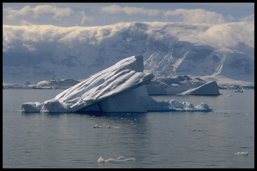 Small iceberg against mountain backdrop. Arndvoort Bay, Antarctica.