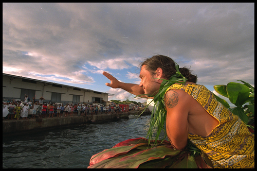 Jean-Marc Van Chinh from France and a resident of French Polynesia waves goodbye to the crowds as the Greenpeace flagship RAINBOW WARRIOR II leaves Papeete, Tahiti, for the French nuclear test site Mo