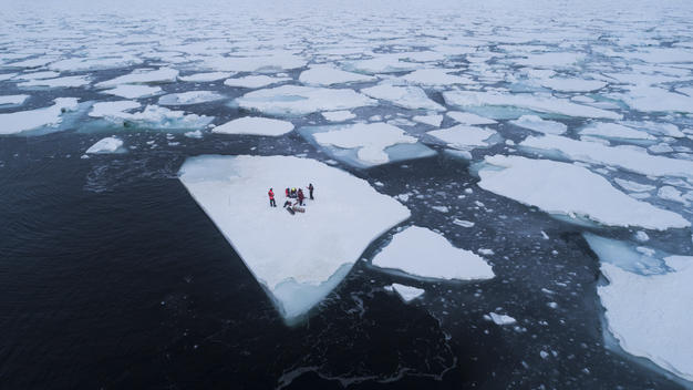 Scientists on Iceberg in the Arctic