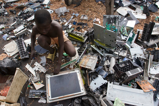 Boy Breaking Computer Components in Ghana