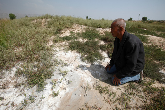 Graves Covered by Coal Ash in China