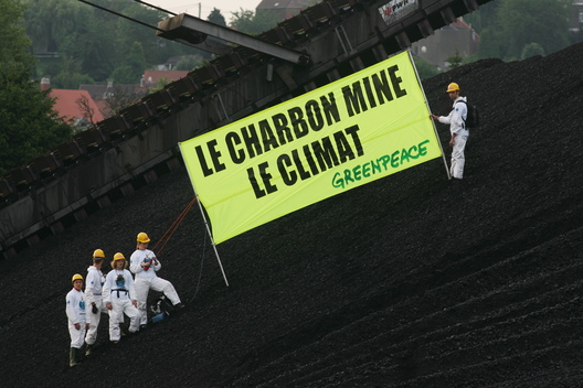 Activists Display banner outside Charleroi Power Plant
