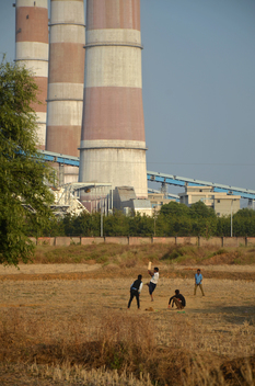 Children playing Cricket in the shadows of the NTPC Sipat Thermal Power Plant