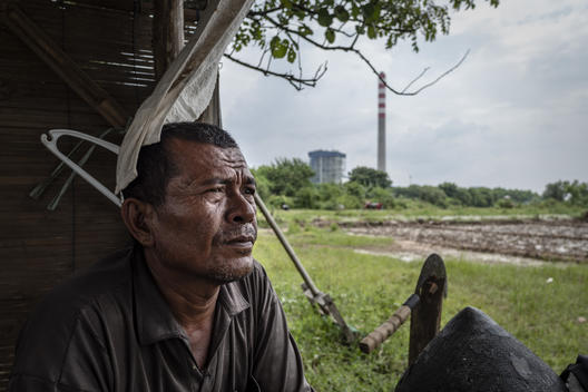 A Shepherd at the Coal Power Plants in Cirebon
