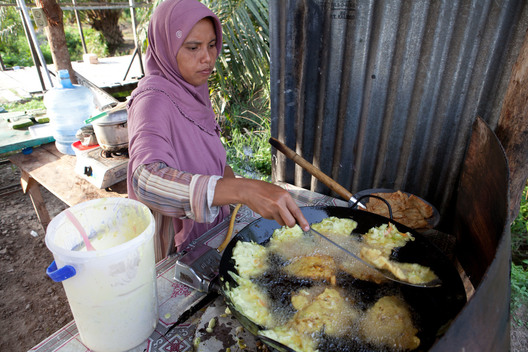 Woman Cooking at a Snack Bar in Sumatra