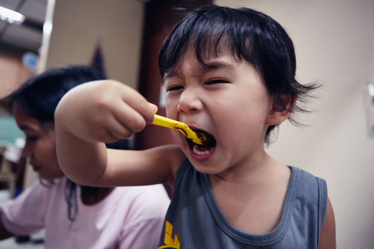 Child Eating a Nutritious Meal in Manila