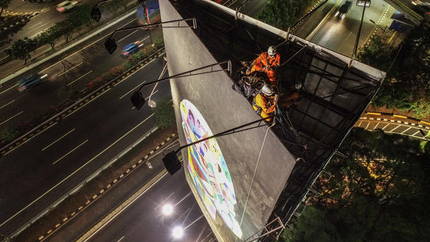Painting Air Quality Billboard in Jakarta