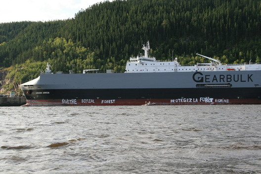 Greenpeace Paints on Side of Freighter