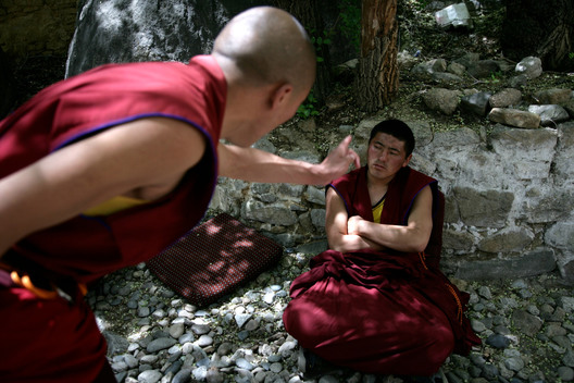 Buddhist Monks Gather Outside the Sera Monastery