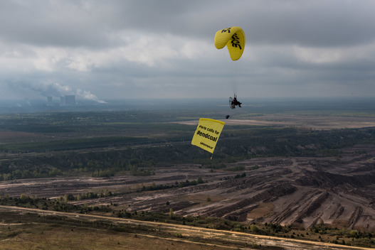 Paraglider Flying Banner over Lignite Mining Area in the Lausitz