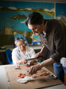 Jerry Natanine Prepares Arctic Char in Clyde River