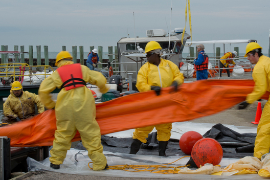 Workers Deploy Boom in Houston Ship Canal Oil Spill