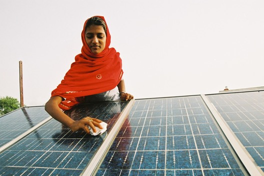 Woman Cleaning Solar Panels in India