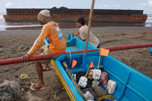 Fishermen near Cilacap Coal Power Plant