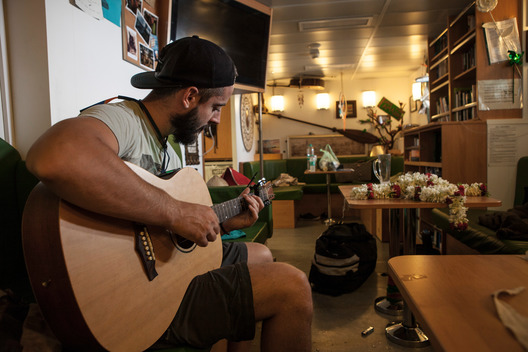 Crew Member Playing the Guitar on the Rainbow Warrior in Goa