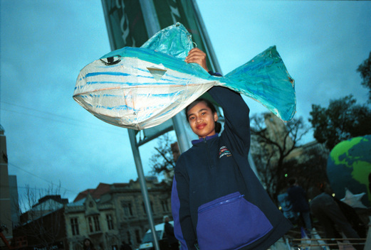 Child with paper whale in Adelaide, Australia, part of the international Kids-for-whales project against whaling and for the set up of a global whale-sanctuary.