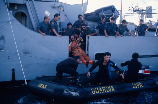Greenpeace activists arrested by the Guardia Civil after blockading the MV BALTICA in Bilbao harbour, Northern Spain.