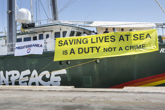 Refugees Rescue Banner on Rainbow Warrior in Palermo