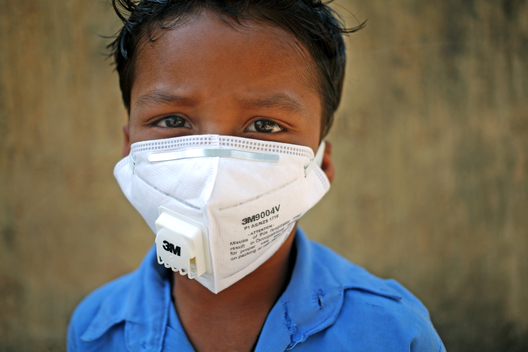 Portrait of young Boy with N95 Respirator in Chhattisgarh