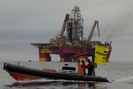 Greenpeace Inflatable in front of Stena Don Oil Rig