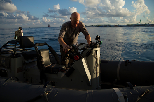 Activist on Inflatable Boat during Research in Mexico