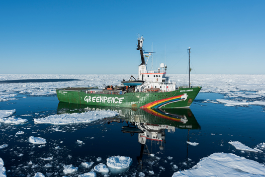 Arctic Sunrise Passes Through Ice Landscape in Greenland