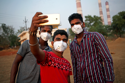 Boys taking a Picture wearing N95 Respirators in Chhattisgarh