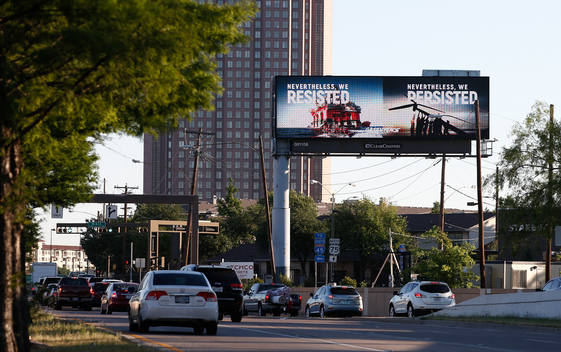 Billboard Messages During Exxon's Shareholder Meeting in Texas