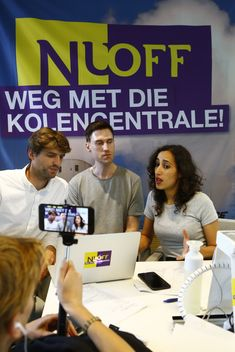 Faiza, Willem and Leon during 'Glass House' Action at NUON Headquarters in Amsterdam