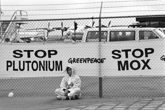 Greenpeace activists try to stop airplane from taking of with freight of plutonium in unsafe containers.