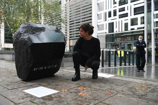 Artist Fiona Banner aka The Vanity Press with 'Klang Full Stop' outside DEFRA in London