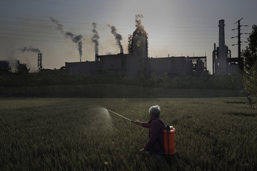 Spraying Crops in front of Steel Plant in Jiangsu