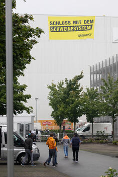 Banner Protest at Meat Factory Toennies in Germany