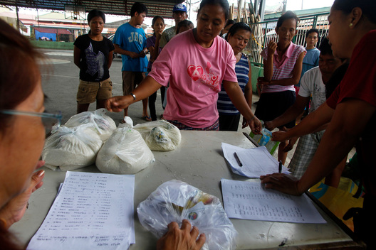 Food in Exchange of Diesel Oil from Spill in the Philippines