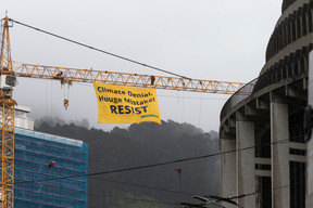 Resist Climate Denial Banner for Rex Tillerson's Arrival in Wellington