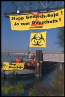 Greenpeace activists occupy barge containing genetically engineered soya at Swiss border.
