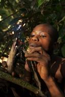 Child Catching Rodent in Congo