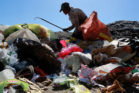 Waste Picker at Waste Dump in Dumaguete, Philippines
