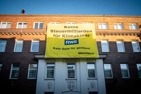 Banner Protest at RWE Headquarter in Essen