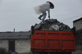 Villager on Truck Transporting Ores in China