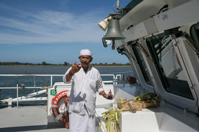 Priest Blessing the Rainbow Warrior in Bali