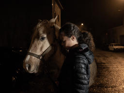 Child with Horse near Factory Farm in Lescout, France