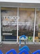 Volunteers Rebrand Tesco's Shop Windows in Belfast, UK