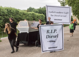Activists Display Diesel Engine in Glass Coffin in Munich