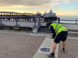 Greenpeace volunteers in Eastbourne spray green recovery messages