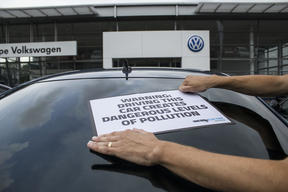 Volunteers Label VW Diesel Cars in Manchester