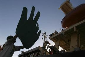 Greenpeace Activists 'Waving Goodbye' to the Crew of a Bulk Carrier
