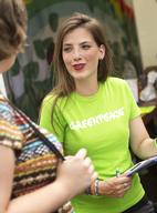 Greenpeace Volunteer Talks to Visitors at Castlefest